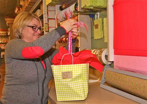 Jackie Wilsberg, Love Lane Sweet Shop owner, ties up a gift on Thursday. Barbaraellen Koch photo.