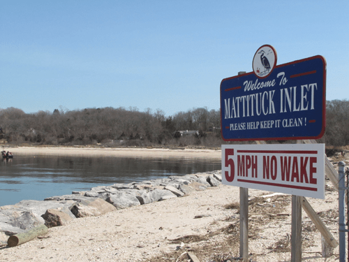 BETH YOUNG FILE PHOTO | Workers will be operating around the clock to get Mattituck Inlet dredged before the state's shut-down window.