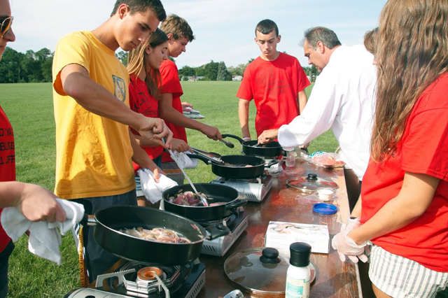 Chris Johnson of CJ's American Grill in Mattituck gives the teens a cooking demonstration. (Credit: Claire Leaden)