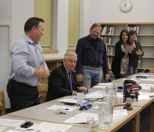 JENNIFER GUSTAVSON PHOTO | The Mattituck school board applauding Superintendent James McKenna moments after he announced his plans to retire.