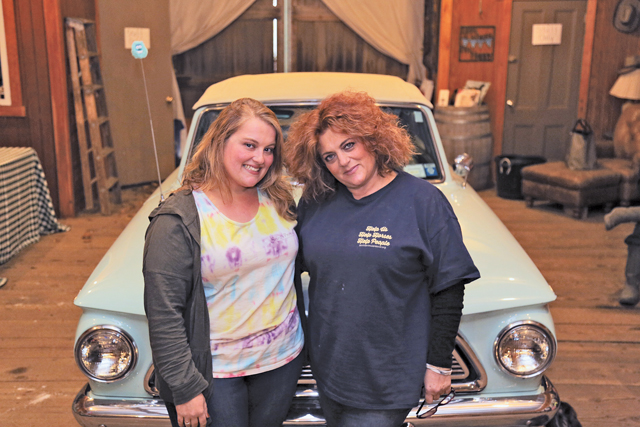 Jessie Siegel (left) and her mother, Marisa Striano, inside the barn at their organization, Spirit's Promise Equine Rescue and Rehabilitation in Baiting Hollow.  (Credit: Krysten Massa)