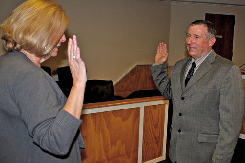 TIM KELLY FILE PHOTO  |  Deputy Town Clerk Linda Cooper administering the oath of office to new Councilman Jim Dinizio last month.
