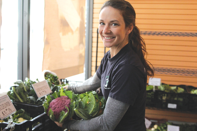 Ms. Senesac with Sang Lee Farms' purple and cheddar cauliflower at Riverhead's indoor farmers market last year. (Credit: Jen Nuzzo)