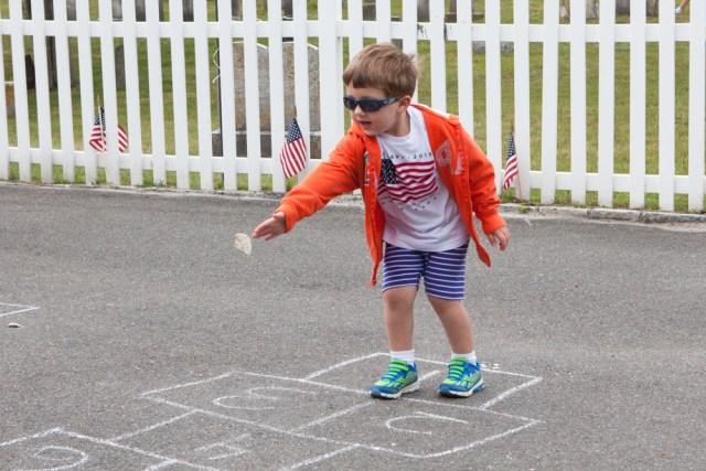 Tony Raynor, 3, of Mattituck enjoying a game of hopscotch.