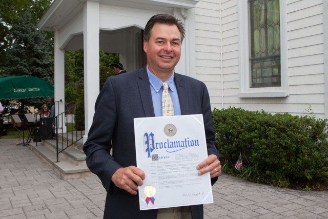 County lawmaker Al Krupski with one of many proclamations handed out during the event.