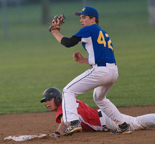 GARRET MEADE PHOTO | North Shore's Anthony Telesca was tagged out by Mattituck second baseman Henry Egan in the second inning when he tried to turn a lined single into a double.