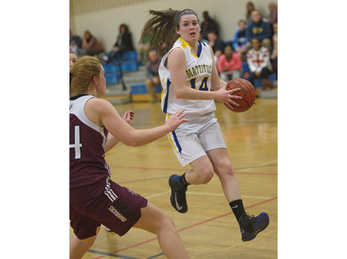 GARRET MEADE PHOTO | Mattituck's Courtney Murphy is guarded by Southampton's Sydney Katz during Tuesday night's game at Cutchogue East Elementary School.