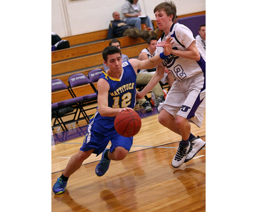 Mattituck junior forward Dan Fedun, dribbling around Hampton Bays' Kris Cheslock, put up 19 points and 12 rebounds for the Tuckers. (Credit: Garret Meade)