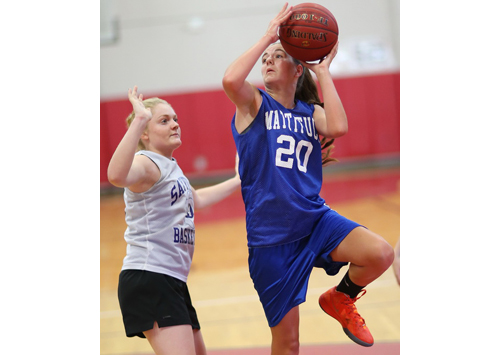 Mattituck freshman Liz Dwyer shooting over Sayville's Molly Andrews during Monday evening's summer league game at Patchogue-Medford High School. (Credit: Garret Meade)