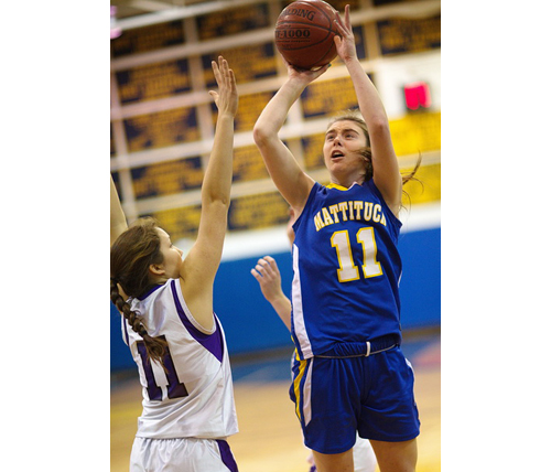 Mattituck's Shannon Dwyer shooting over Hampton Bays' Hannah Reed during the county Class B final at Northport High School on Tuesday. (Garret Meade photo)