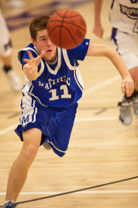 GARRET MEADE PHOTO | Tyler Connell of Mattituck reaching out to collect the ball during Tuesday night's game in Port Jefferson.