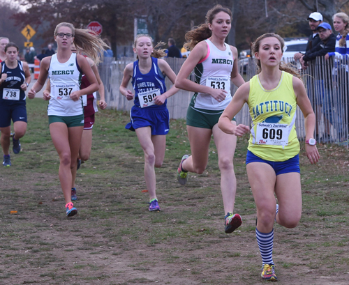 Mattituck junior Melanie Pfennig, leading the pack early in the Class C race, led the Tuckers to a second straight county championship on Friday at Sunken Meadow State Park. (Credit: Robert O'Rourk)