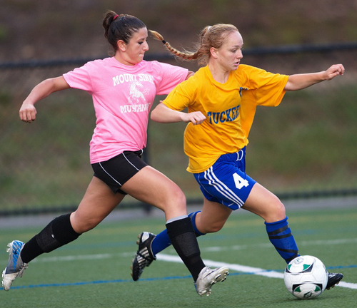 GARRET MEADE PHOTO | Mattituck striker Abby Graeb, with a Mount Sinai defender chasing her, closing in on her first goal of the game.