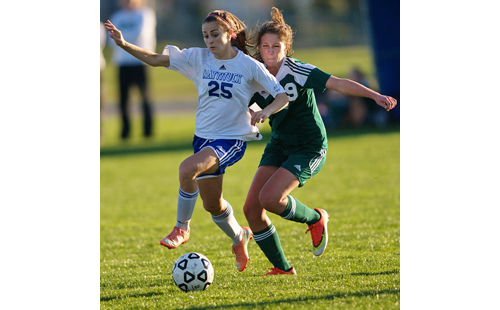 GARRET MEADE PHOTO | Ayla Ayoub, who scored her first career hat trick for Mattituck, races to the ball with Bishop McGann-Mercy's Ali Hulse.