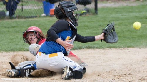 Southold/Greenport's Toni Esposito slides home before Mattituck catcher Rachel Voegel receives a throw home during Friday's game at Mattituck High School. (Credit: Katharine Schroeder)