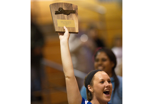 GARRET MEADE PHOTO   One of Mattituck's captains, Laurel Bertolas, holding up the third Long Island championship plaque the Tuckers have won in four years.