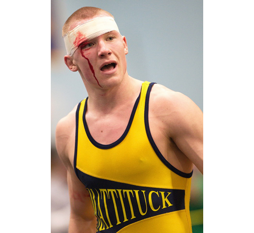 GARRET MEADE PHOTO | Tomasz Filipkowski of Mattituck/Greenport, who sustained a cut on his right eyebrow 10 seconds into the 170-pound final, went on to defeat Half Hollow Hills East's Maleik Henry, 4-3. Filipkowski was selected the tournament's most outstanding wrestler.