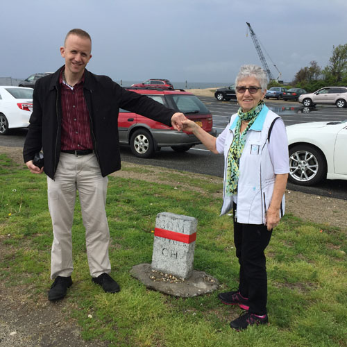 Derek Stadler and his mother, Hannelore, of Hicksville, pose next to Southold Town's 30th mile marker in Orient. (Rachel Young photos)