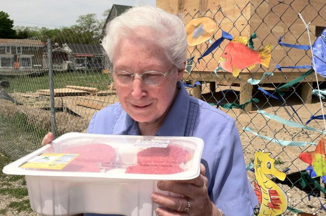Sister Margaret Smyth and a pack of hamburgers she's going to help distribute to families in need. (Credit: Michael White)