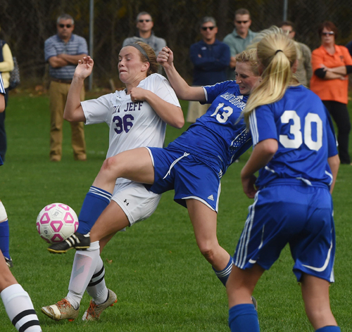 Mattituck senior Nikki Zurawski (13) fights for position against Port Jefferson's Olivia Love. (Credit: Robert O'Rourk)