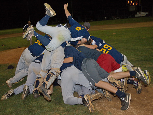 GARRET MEADE PHOTO | The North Fork Ospreys formed a happy pile after winning their second league championship in four years.