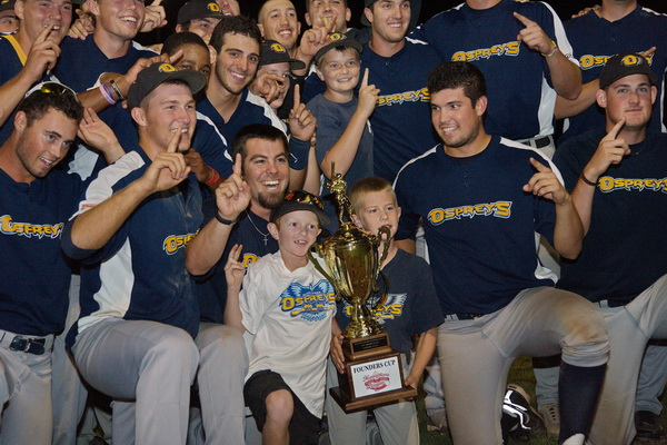 GARRET MEADE PHOTO | North Fork players posing for photos with the trophy they won as the first Hamptons Collegiate Baseball League champions.