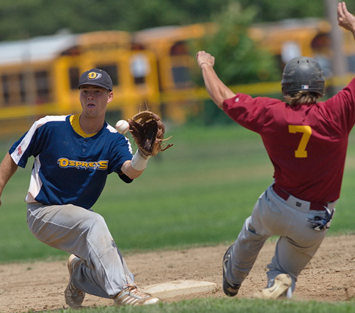 GARRET MEADE PHOTO | North Fork shortstop Eric Solberg is about to tag out Riverhead's Jack Sundberg, who tried to steal second base in the third inning.