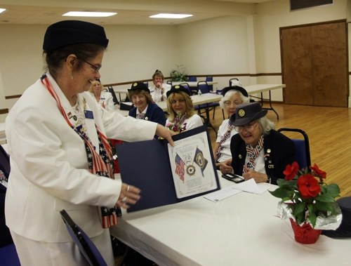 American legion Ladies Auxiliary president Patricia Bianculli presents Evelyn McConlogue of East Marion with an award for her more than 75 years of service. (Credit: Beverlea Walz)