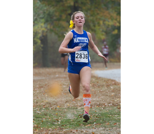 ROBERT O'ROURK PHOTO  |  Mattituck freshman Melanie Pfennig, shown here during the division championship, helped lead the Tuckers to a second straight county title Saturday at Sunken Meadow State Park.