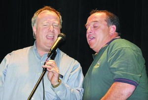 Doug Wald (left), who founded the Sing East End Karaoke night, is joined by friend Mark Stark in a tune at last year's inaugural event at Vail-Leavitt Music  Hall. This year's event, a fundraiser for East End Hospice, is scheduled for Saturday, March 12.