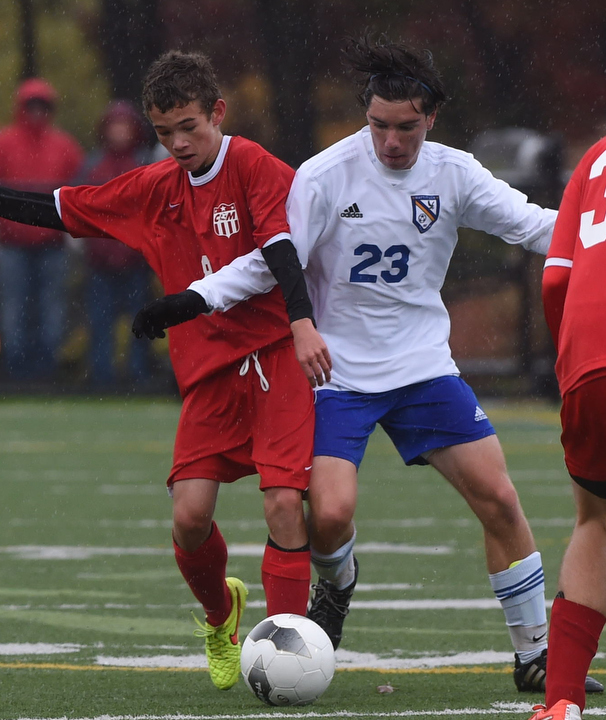 Mattituck midfielder Kevin Diffley vies for the ball with Jack Wicks. (Credit: Robert O'Rourk)