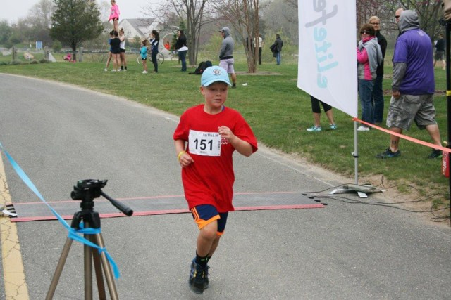 Andrew McKenzie, 8, was the winner of the mile race. (Credit: Robert Styron/Peconic Landing)