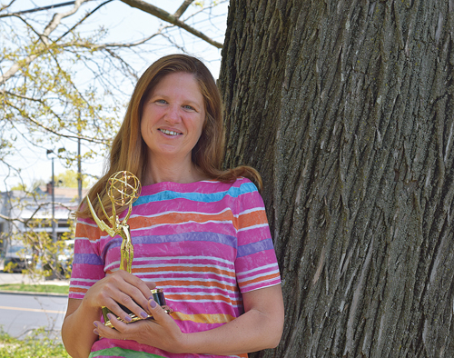 Freelance photographer and videographer Randee Daddona with the Emmy award she received Saturday. (Credit: Vera Chinese)