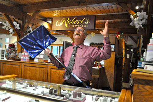 RACHEL YOUNG PHOTO |  Robert's Jewelers owner Robert Scott, snow shovel in hand, at his Southold store last Thursday morning.
