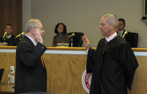 Southold Town Justice Rudolph Bruer, left, and William Price at Judge Bruer's swearing in ceremony in 2012. (Credit: Beth Young file photo)