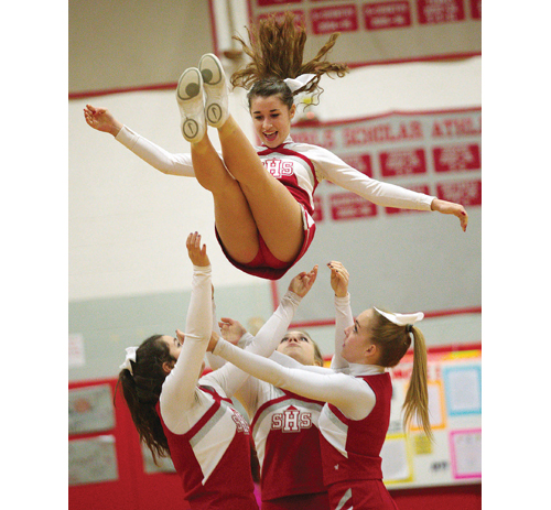 Southold cheerleaders perform during a basketball game this past winter. (Credit: Garret Meade)