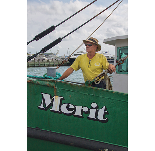 Sid Smith, who captains The Merit fishing boat out of Greenport, believes he's being punished by village officials for being outspoken over issues concerning the village. He was told to vacate the railroad dock earlier this year for not having enough insurance. (Credit: Paul Squire)