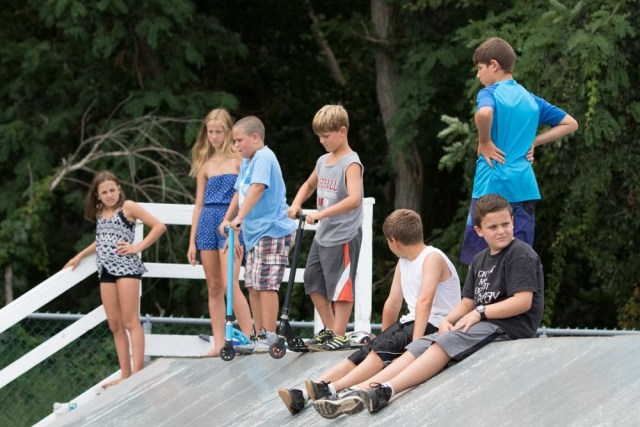 A group of youngsters survey the course before beginning to skate.