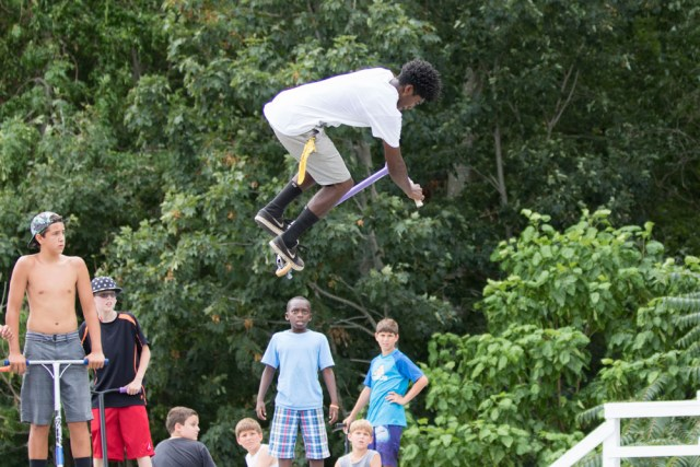 Darius Brew, 16, of Mattituck does a stunt while admirers look on.