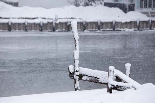 KATHARINE SCHROEDER PHOTO | Snowfall coats a dock in New Suffolk.