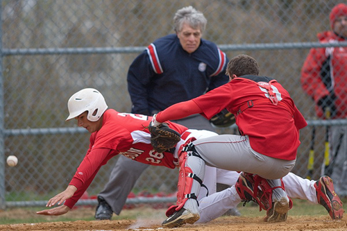 GARRET MEADE PHOTO | Aaron Schiavoni dove head first to score Pierson/Bridgehampton's second run in the first inning while the ball eluded Southold catcher Matt Stepnoski.