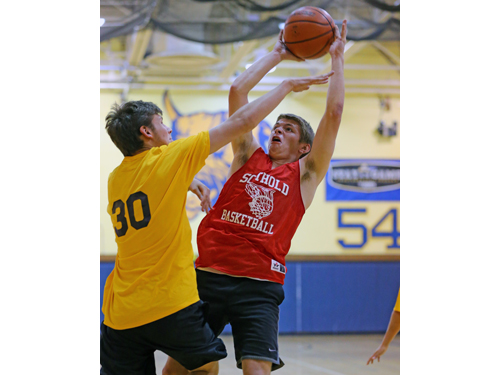 Southold's Aidan Walker goes up for a shot while being guarded by Shoreham-Wading River's Kieran Qualley. (Credit: Daniel De Mato)