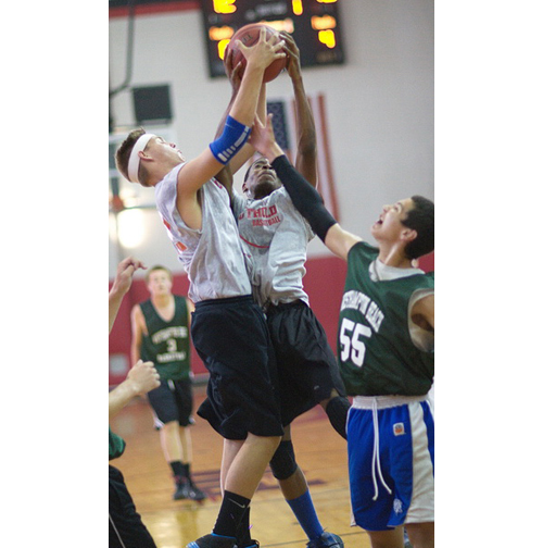 GARRET MEADE PHOTO | Southold's James Penny, far left, and Damiko Jones get their hands ona  rebound that Liam Huysimon of Westhampton Beach is reaching for.