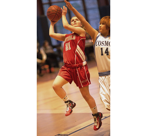 GARRET MEADE PHOTO | Justina Babcock of Southold attempting a layup while The Ross School's Asuko Saito defends.