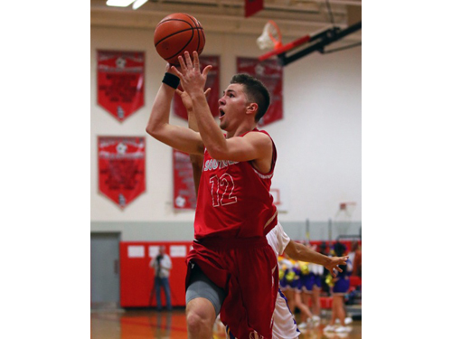 DANIEL DE MATO PHOTO | Liam Walker of Southold sinking a layup for 2 of his 30 points against Greenport on Monday night.