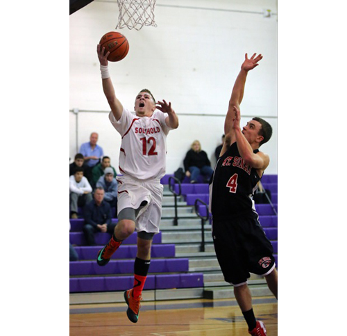 DANIEL DE MATO PHOTO | Southold's Liam Walker beats Mount Sinai's Coles Williams to the basket for a layup. Walker scored 13 of his game-high 16 points in the second half.