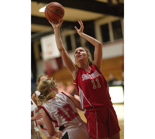 GARRET MEADE FILE PHOTO | Nicole Busso, one of Southold's five seniors, shooting over Pierson/Bridgehampton's Holly Zappola.