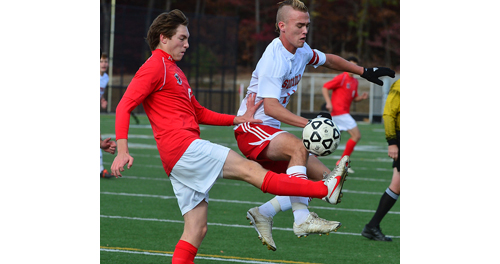 ROBERT O'ROURK PHOTO | Southold's Will Richter goes airborne in an attempt to win possession of the ball.