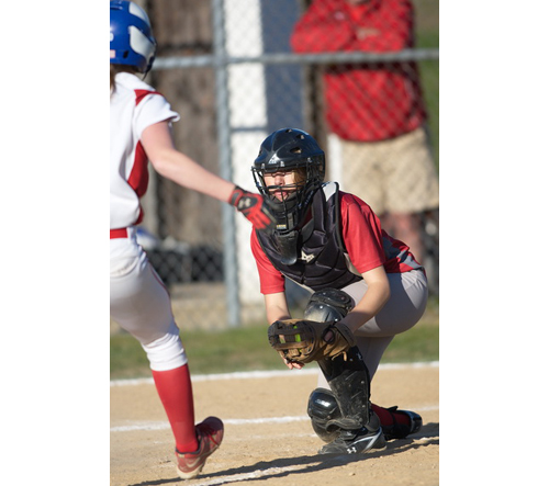 GARRET MEADE PHOTO   Southold/Greenport catcher Wendy Peterson caught a throw from third baseman Alexandra Small for a forceout at home plate of Center Moriches' Cheyenne Raimondi.