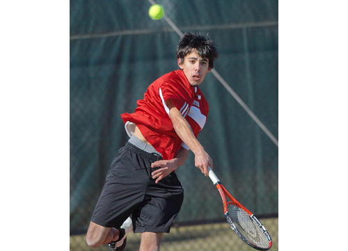 GARRET MEADE PHOTO | Southold/Greenport's first singles player, Devyn Standish, battled cold, windy weather, frustration and his opponent, Longwood's Dave Barlow.